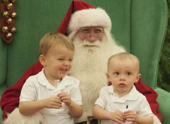 C.J. (left) and Lincoln Carty get one-on-one time with Santa at the Moorestown Mall in 2015.