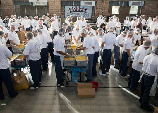Co-sponsored by the Outreach Program, about 160 inmates volunteered their time to put together 150,000 meals for the homeless at the Chillicothe Correctional Institution Tuesday morning in Chillicothe, Ohio.