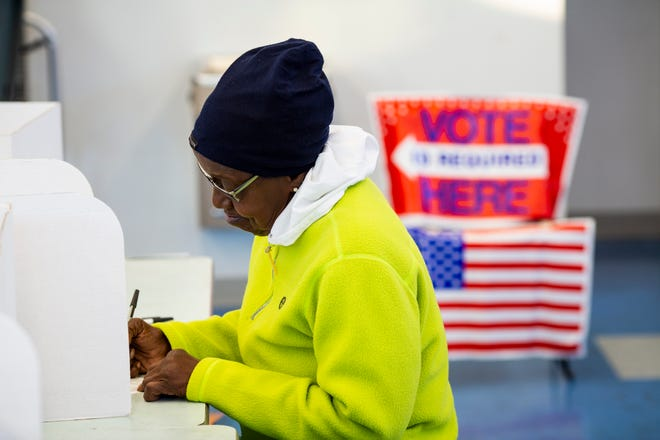 A voter casts her ballot at the The Carnegie/Eva Farris Education Center in Covington, Kentucky Tuesday, November 6, 2018.