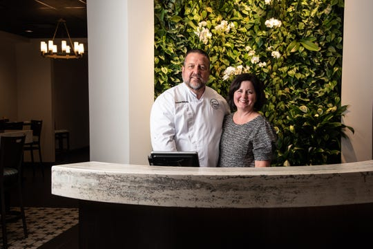 Tano and Gina Williams inside their newly reopened Tano Bistro in Historic Loveland.