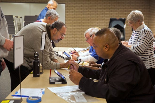 Hair Rechnitzer prepares to vote on Election Day at the Blue Ash Recreation Center.