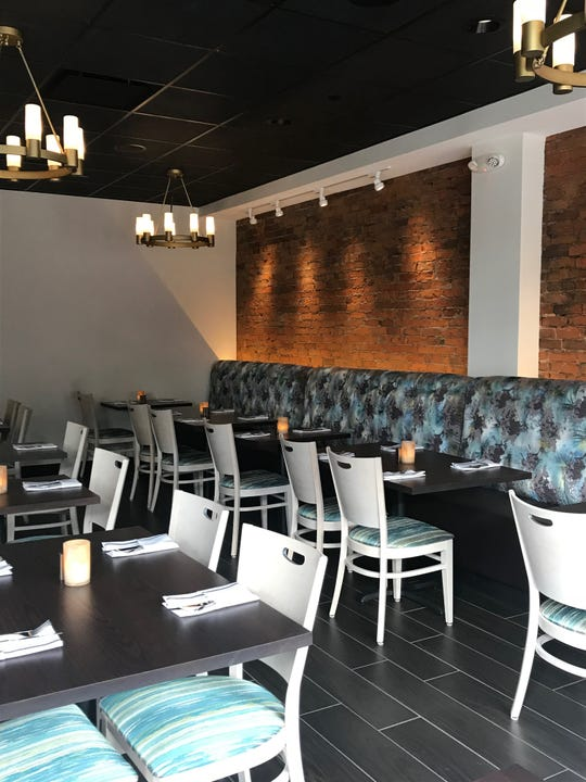 A dining area inside the newly reopened Tano Bistro in Loveland.