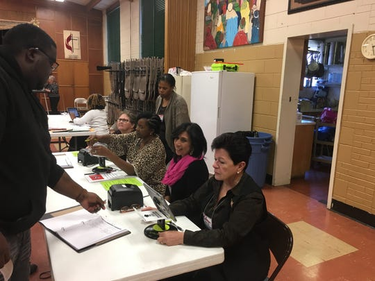 Voters sign in at the New Providence United Methodist Church polling station on Tuesday, Nov. 6, 2018.
