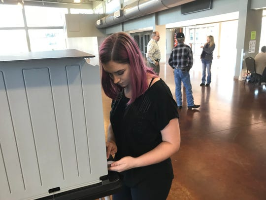 Justice McAfee, 19, votes for the first time at Wilma Rudolph Event Center.