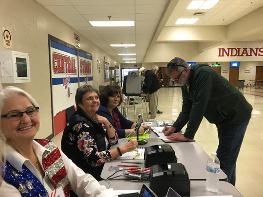 Jeff Parchman signs in to vote at Montgomery Central Middle School on Tuesday morning.