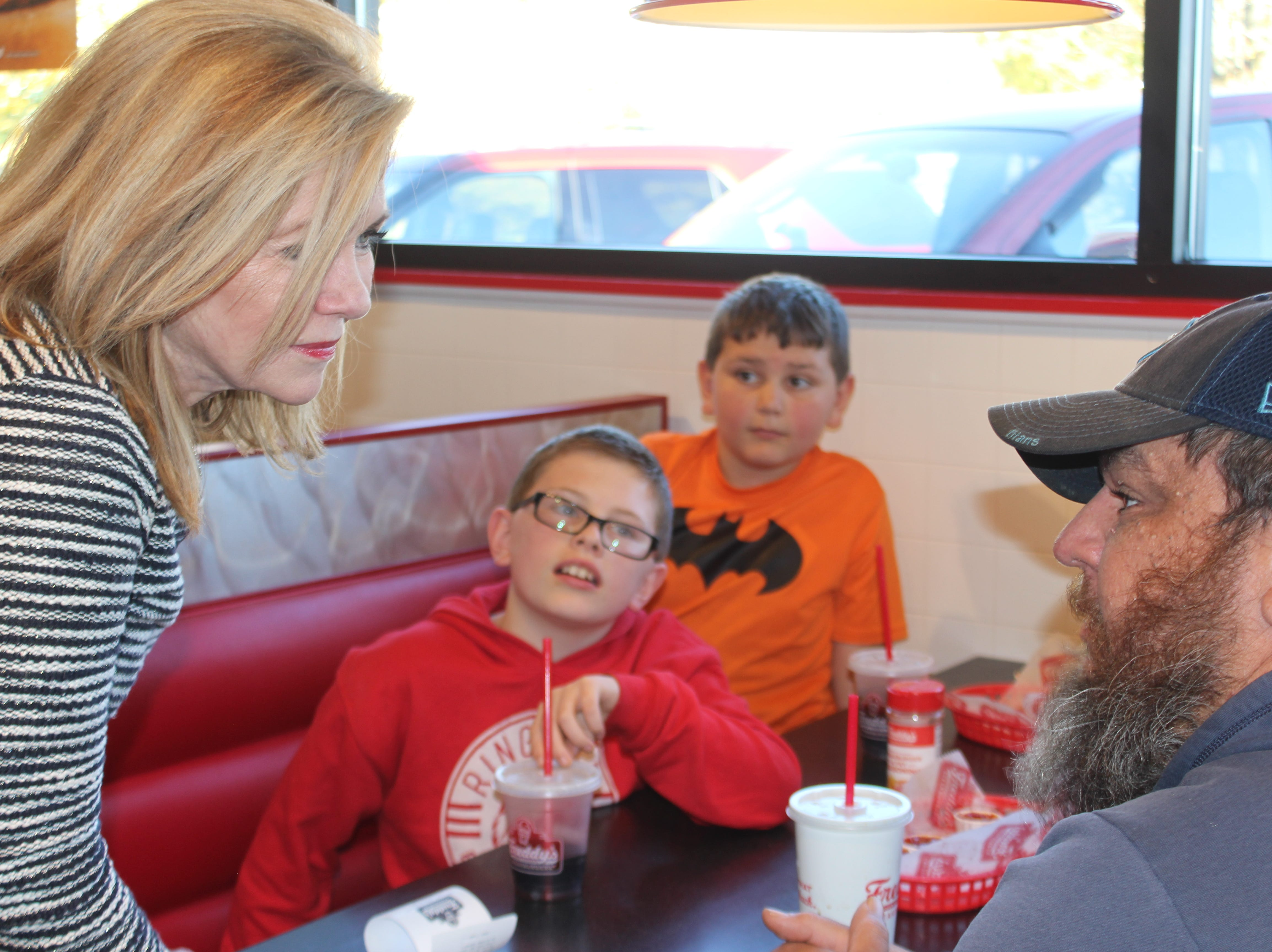 Republican Rep. Marsha Blackburn greets voters at the final stop of her campaign for Senate at Freddy's Steakburgers in Clarksville on Election Day, Nov. 6.