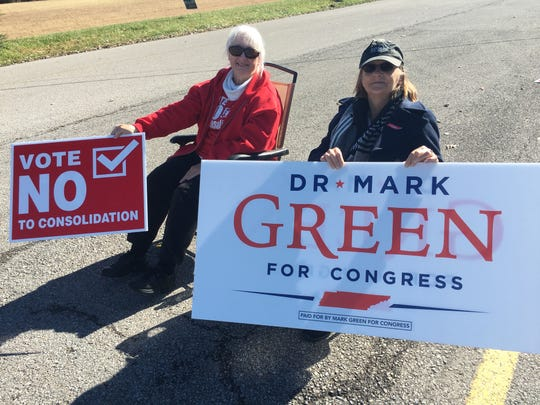 Donna Kent, left, an administrator for the Committee to Oppose Consolidation, and Tammye Green, campaigning for Republican congressional candidate state Sen. Mark Green, outside Woodlawn Elementary School on Tuesday, Nov. 6, 2018.