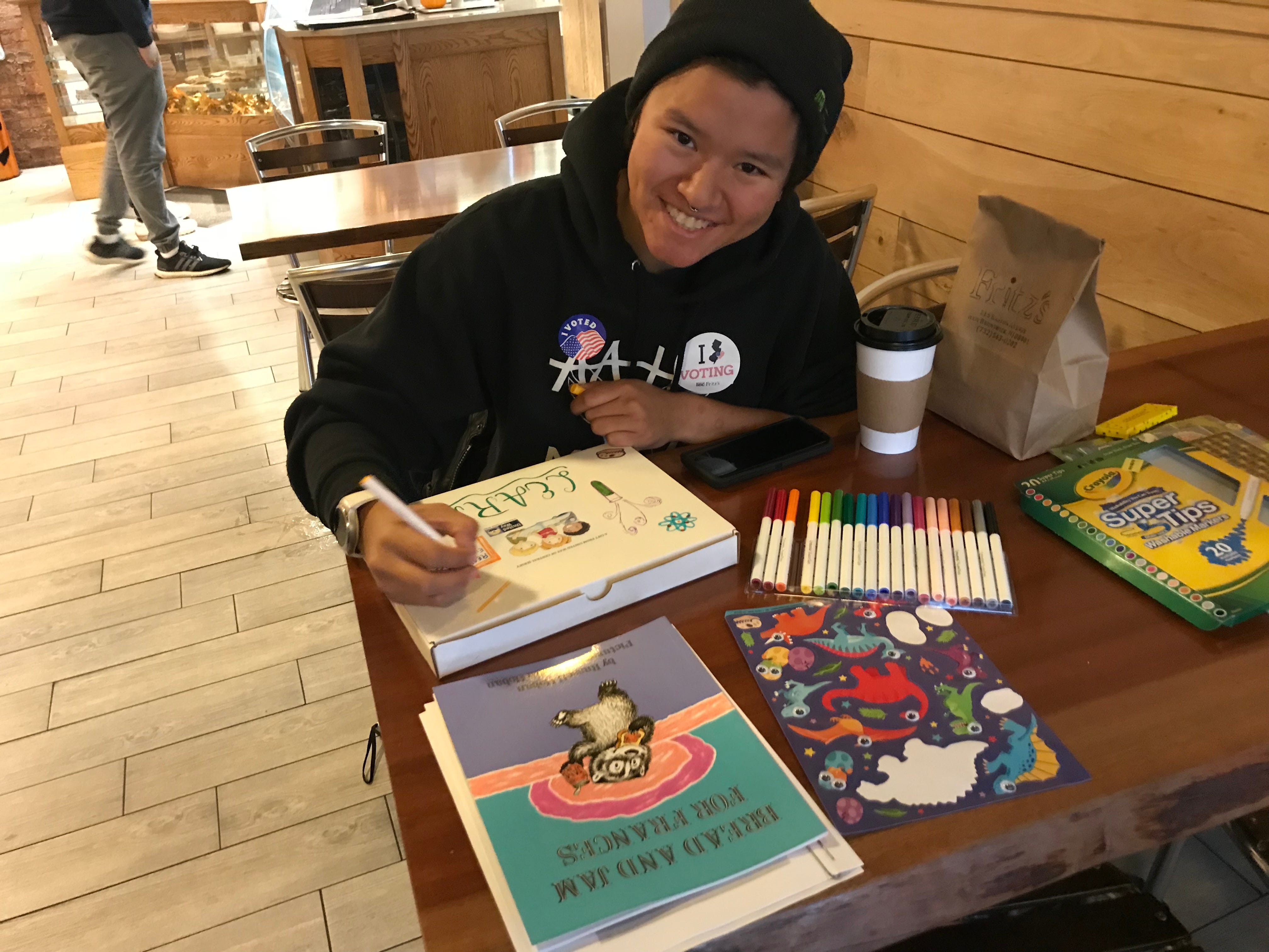 Rutgers University junior Michala Rose works on literacy kits at the Voting Party hosted by the United Way of Central Jersey in New Brunswick.