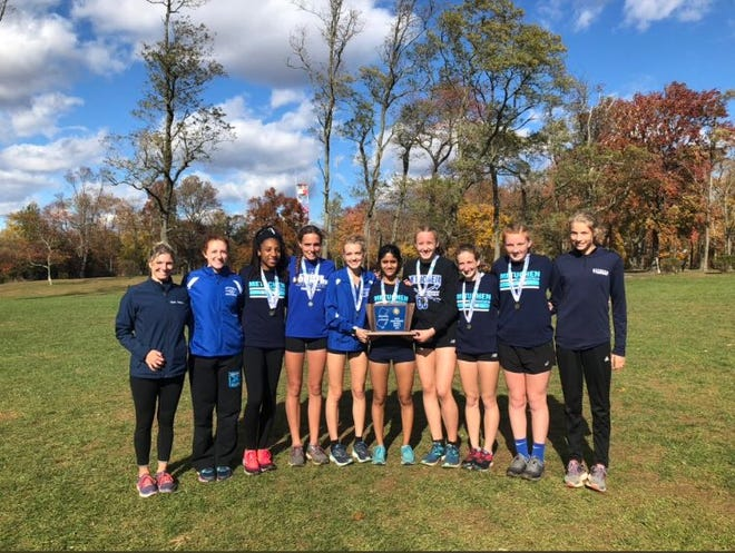 The Metuchen girls cross country team poses after winning the 2018 Central Group II sectional.