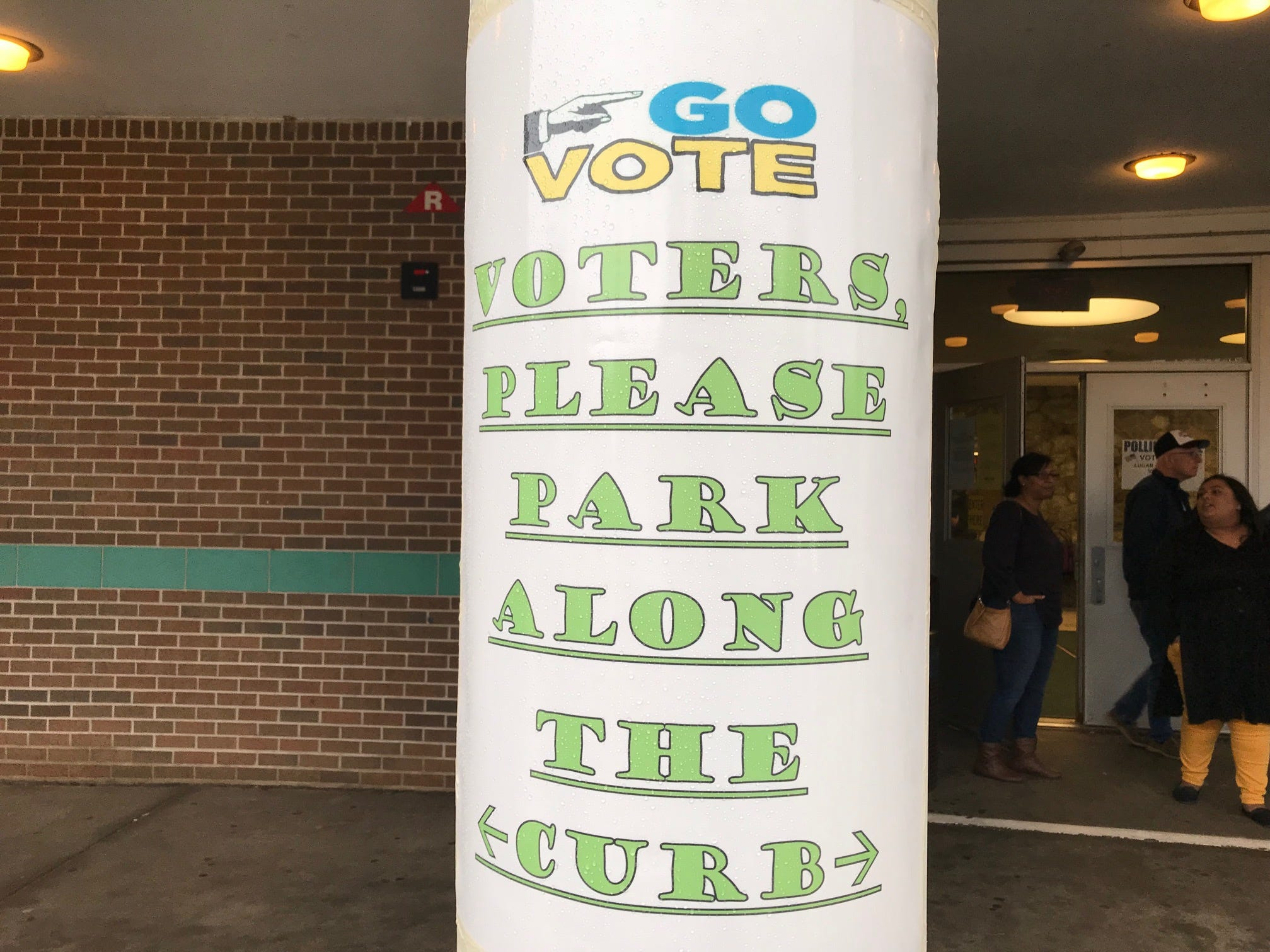 Voters at J.P. Stevens High School in Edison were directed where to park with signs like this.
