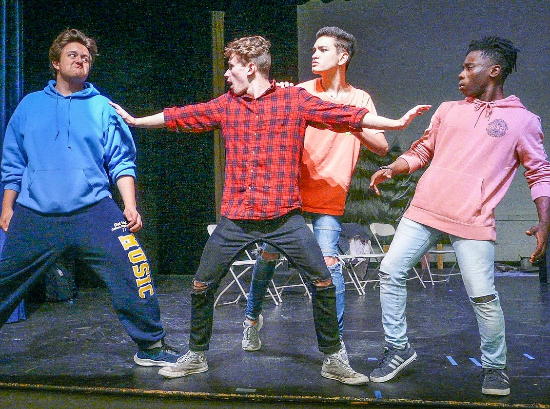 "Rehearsing Delaware Valley High School's production of ""Drama Rehab,"" four type-cast actors scuffle during a therapy session. They are, from left, Hunter Trstensky as Melodramatic Villain, Mark Westling as Theater Guru, Thai Branowski as Herr Direktor and Bryant Kessie as Super Hero. The show goes on Nov. 15 to 17 at 7 p.m."