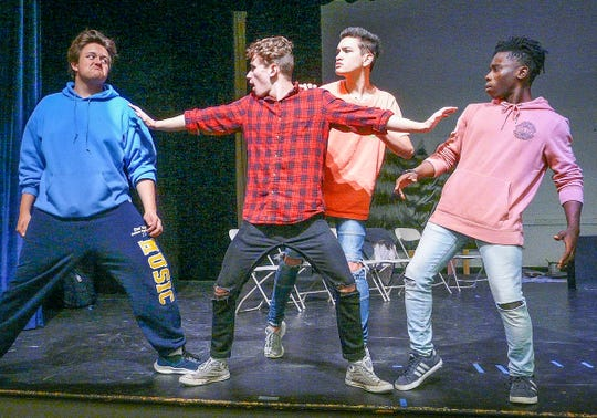 """Rehearsing Delaware Valley High School's production of """"Drama Rehab,"""" four type-cast actors scuffle during a therapy session. They are, from left, Hunter Trstensky as Melodramatic Villain, Mark Westling as Theater Guru, Thai Branowski as Herr Direktor and Bryant Kessie as Super Hero. The show goes on Nov. 15 to 17 at 7 p.m."""