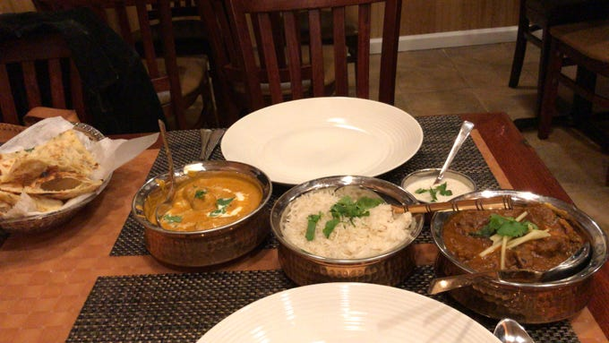 A meal of naan bread, the vegetarian dish malai kofta, rice, yogurt sauce and goat curry is served at the new Kabab Factory in Metuchen.