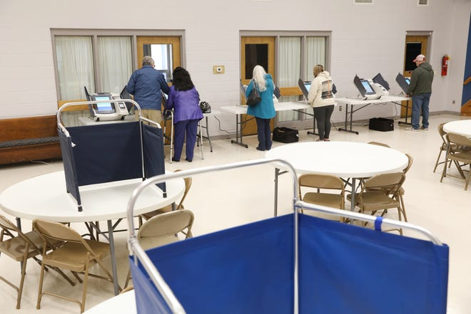 Voters cast their ballots at Roscoe United Methodist Church in Coshocton.