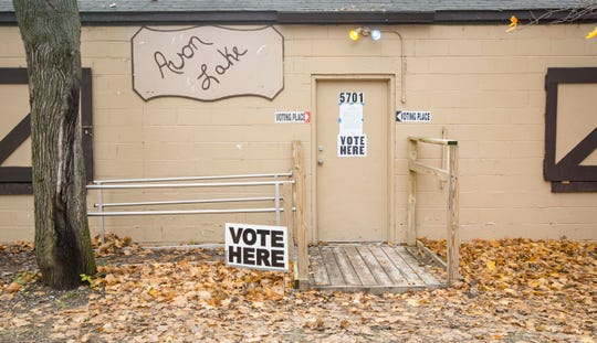 The Avon Lake clubhouse is used for a polling station in  the midterm elections, Tuesday, Nov. 6, 2018, near Carlisle, Iowa.