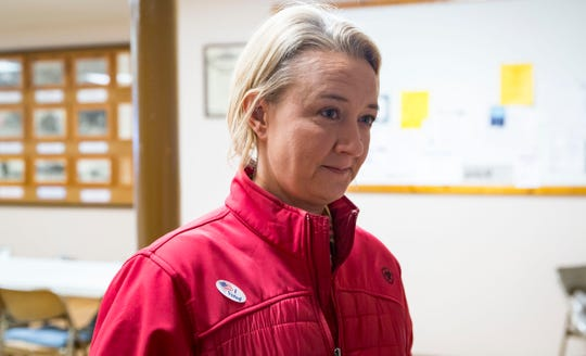 Sabrina Johnson, 41, after casting her vote Tuesday, Nov. 6, 2018, in Lacona, Iowa.