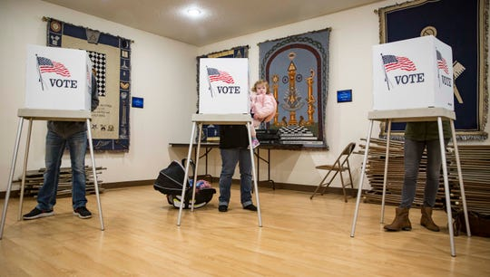 Voters cast their ballots in the midterm elections at the Masonic Temple, Tuesday, Nov. 6, 2018, in Indianola, Iowa.