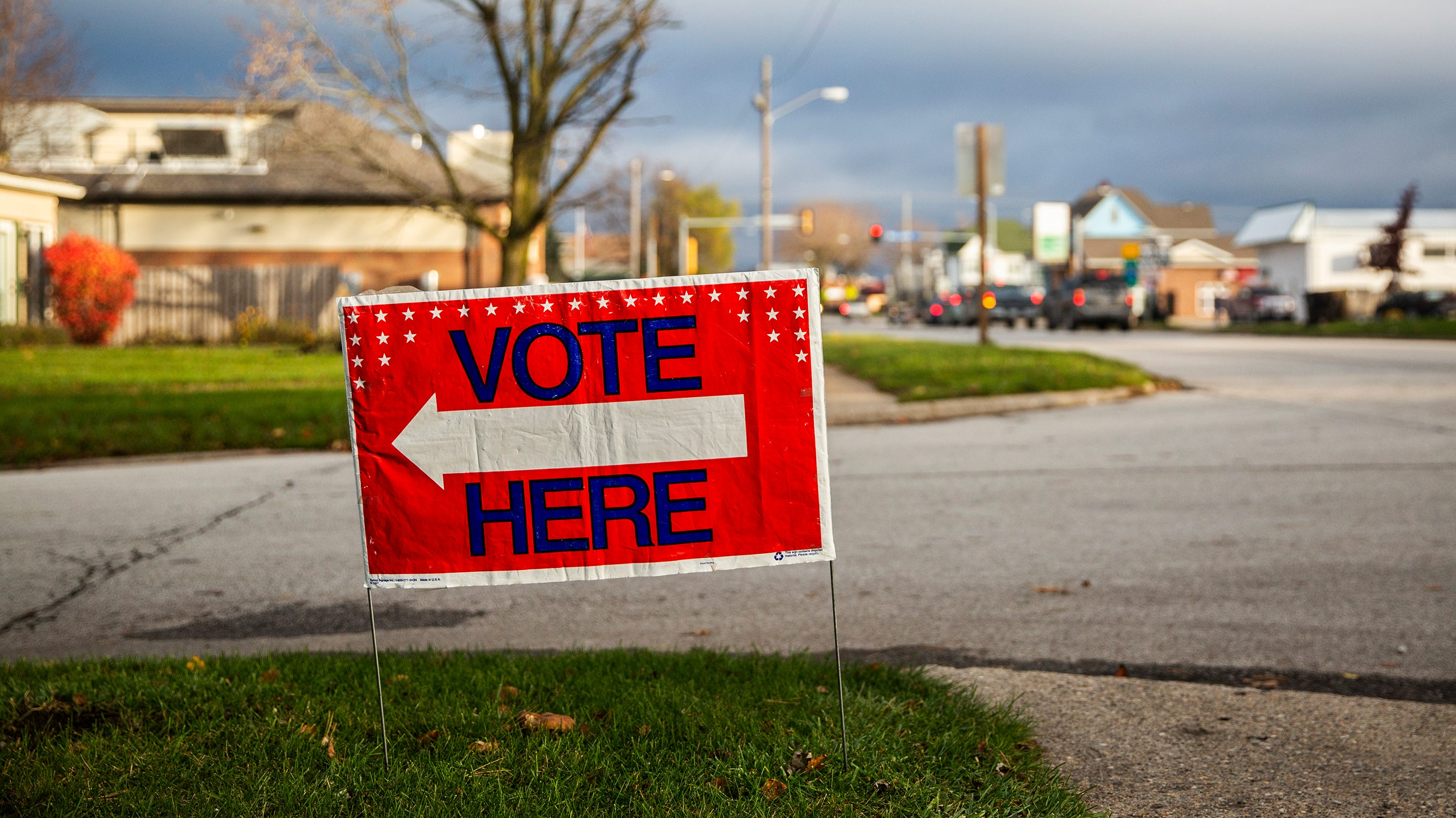 A Vote Here sign sits on a corner in Osceola pointing toward the United Methodist Church, one of the polling places in the city, on Tuesday, Nov. 6, 2018. Polls in Iowa are open from 7:00AM to 9:00PM.