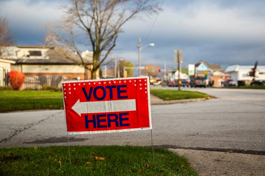 A Vote Here sign sits on a corner in Osceola pointing toward the United Methodist Church, one of the polling places in the city, on Tuesday, Nov. 6, 2018.