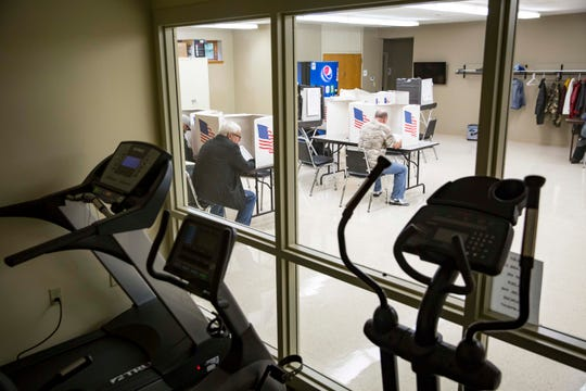 Voters fill out their ballots at the Norwoodville Community Center in central Iowa in the midterm elections, Tuesday, Nov. 6, 2018, near Des Moines, Iowa