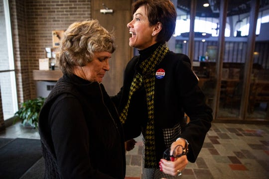 Iowa Gov. Kim Reynolds greets voters and poll workers after voting in the 2018 election on Nov. 6, 2018, in her hometown of Osceola.