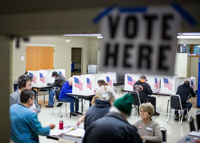 Voters fill out their ballots at the Norwood community center  in central Iowa in the midterm elections, Tuesday, Nov. 6, 2018 near Des Moines, Iowa