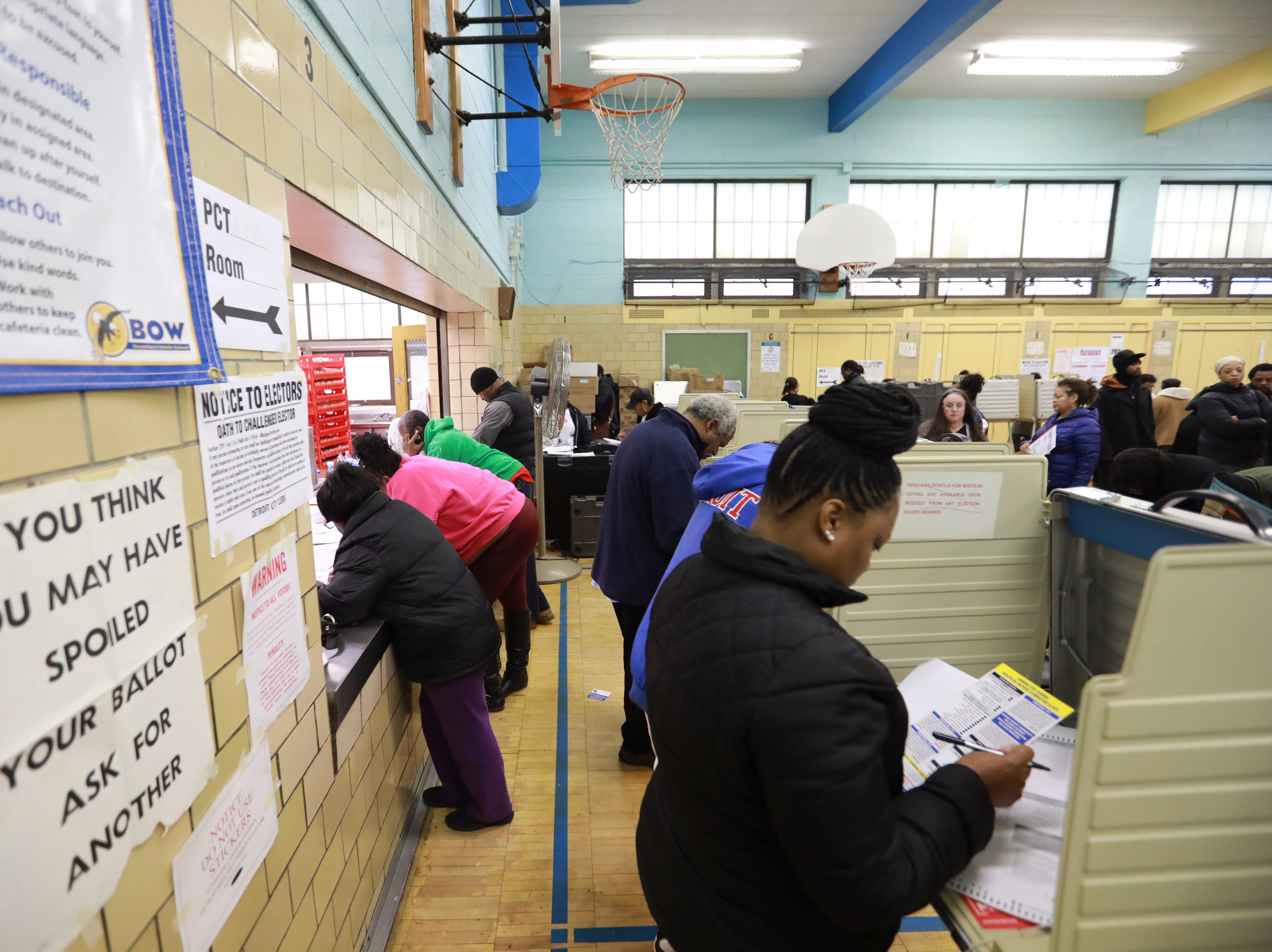 Detroit residents vote at Bow Elementary School  where multiple precincts are located for the midterm elections in Detroit on Tuesday, Nov. 6, 2018.