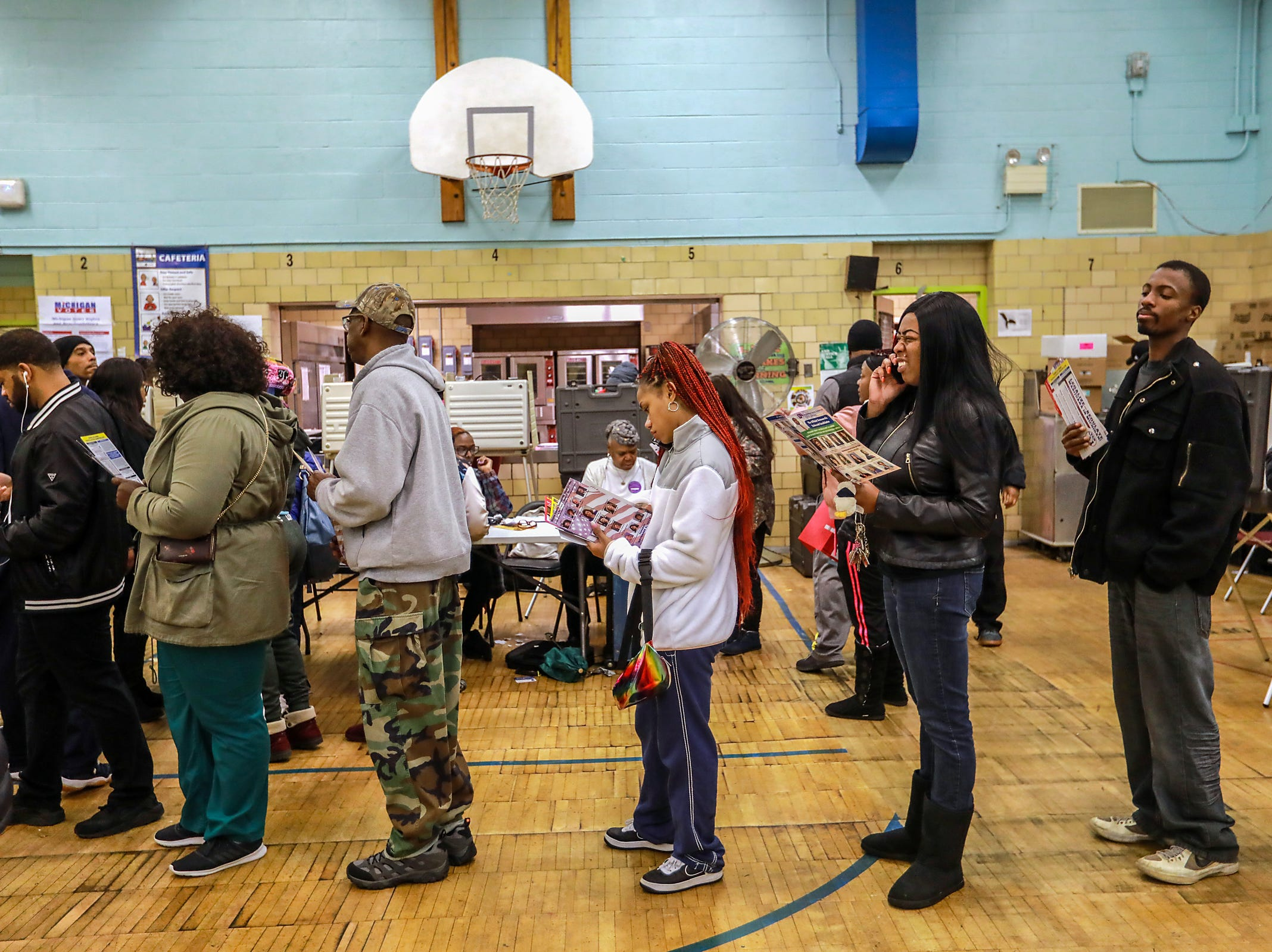 Voters stand in line waiting to cast their ballot at Bow Elementary School  where multiple precincts are located for the midterm elections in Detroit on Tuesday, Nov. 6, 2018.