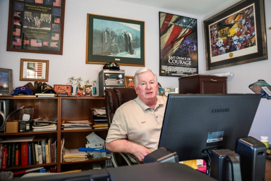 Kent Hall, associate director for Honor For All,  sits in his home office on Oct. 25 in Williamston, where he is a city council member. Hall is a convicted serial bank robber who says he suffers from post-traumatic stress disorder and is naming a trail in Memorial Park in Williamston to honor veterans and first responders lost to suicide due to post-traumatic stress and traumatic brain injury.