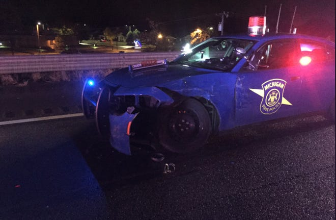 A Michigan State Police patrol car was struck on I-94 while parked in the right lane.