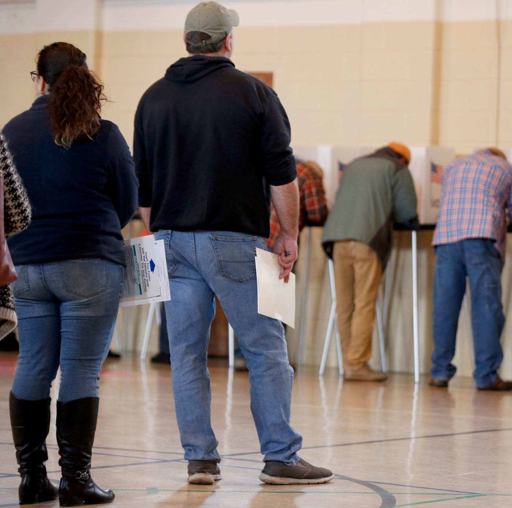Voters line up waiting for an open spot to to cast their ballots inside the gymnasium at Union Lake Baptist in Commerce Township on November 6, 2018.