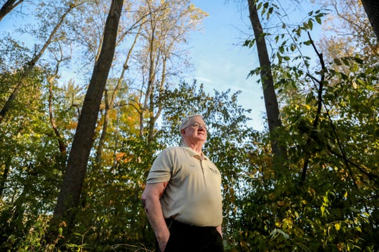 Kent Hall, associate director for Honor For All, stands on Oct. 25 at a trail in Memorial Park in Williamston that will be renamed to honor veterans and first responders lost to suicide due to post-traumatic stress and traumatic brain injury.