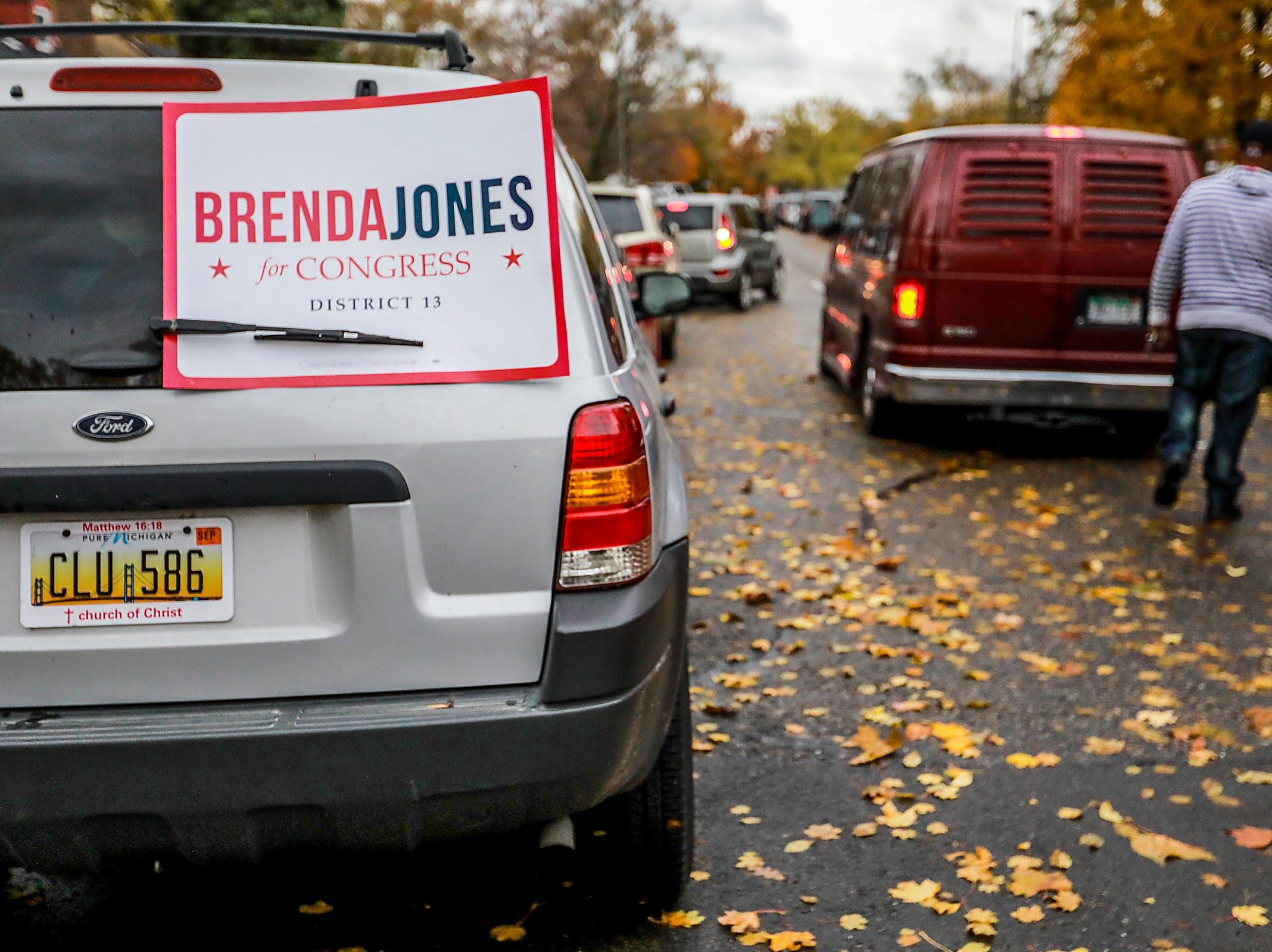 A car can be seen with a Brenda Jones campaign sign as traffic backs up in front of Bow Elementary as people come to vote in the  Michigan midterm elections in Detroit on Tuesday, Nov. 6, 2018.