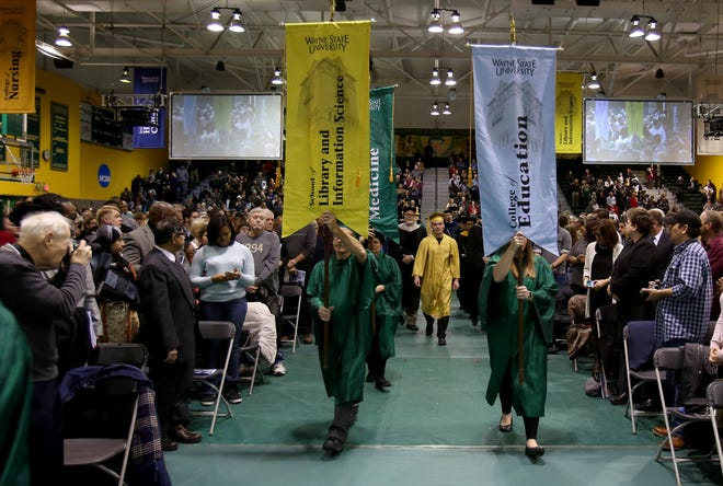College grads often begin repaying those student loans six months after graduation. But what kind of repayment plan do you choose? Wayne State University graduation ceremonies in Detroit in December 2016.
