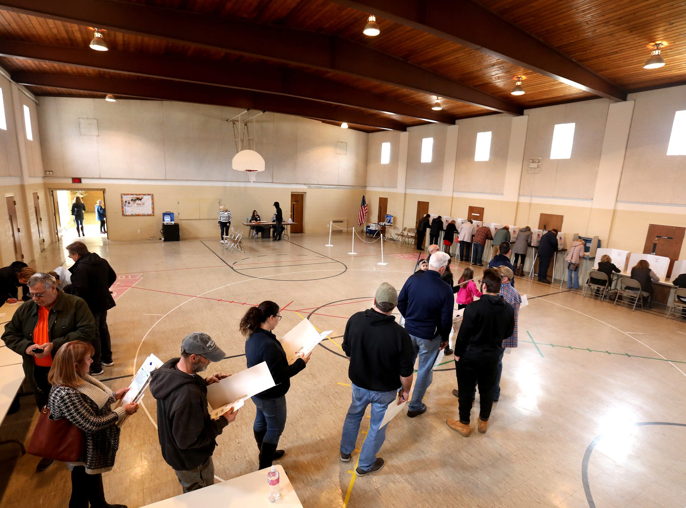 Voters stand in line as they wait to fill out their ballots at Union Lake Baptist in Commerce Township, Michigan on November 6, 2018.