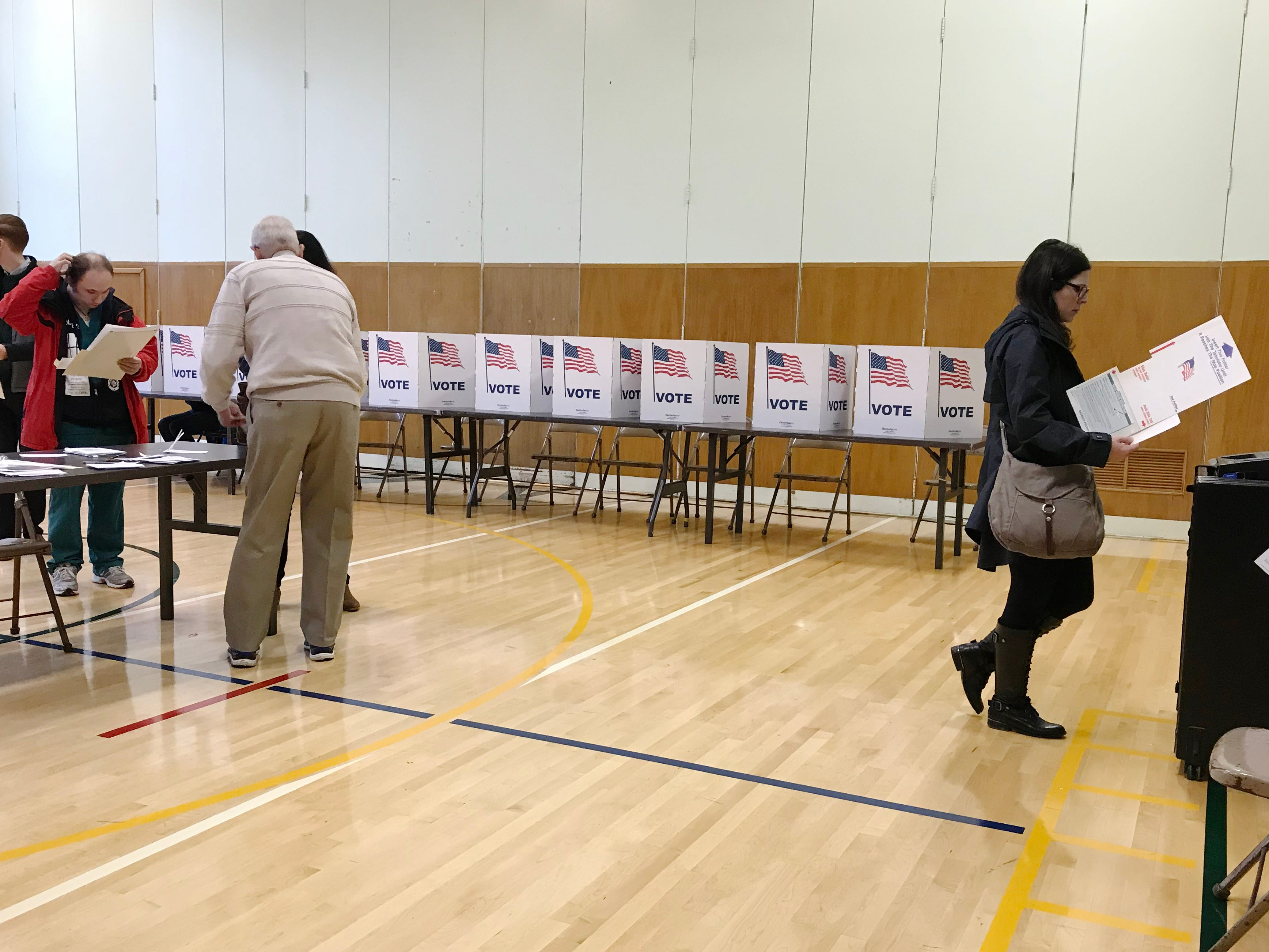 Voters cast their ballots in the gymnasium at Monteith Elementary School on midterm election day, Tuesday, Nov. 6, 2018 in Grosse Pointe Woods, Michigan.