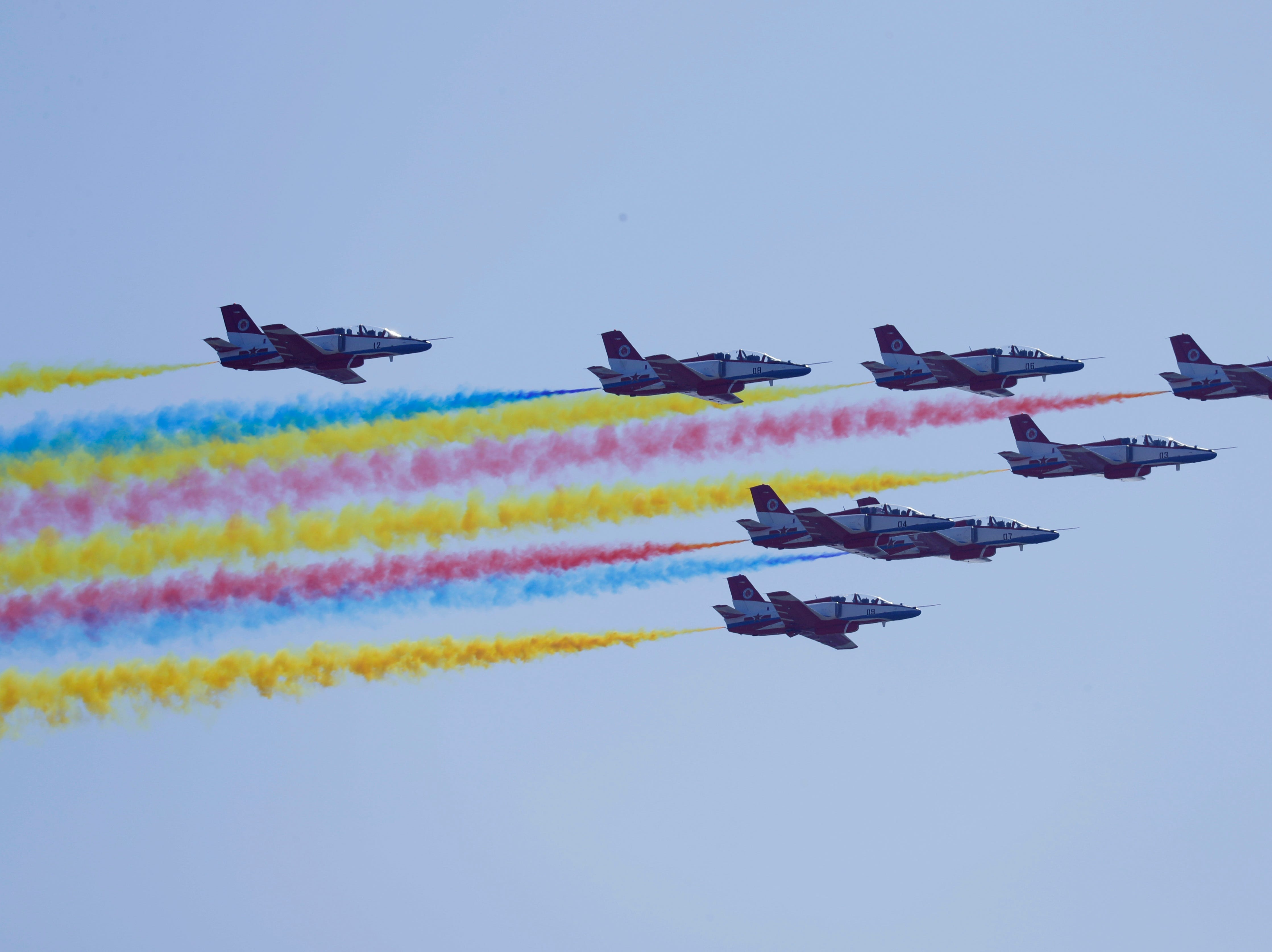 "China's K-8 aircraft from the Aerobatic Team ""Hongying,"" meaning Red Eagle, of the Chinese People's Liberation Army Air Force perform during the 12th Airshow China 2018, Tuesday, Nov. 6, 2018."