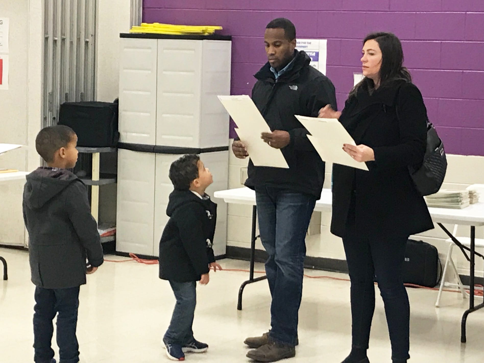 Republican U.S. Senate candidate John James votes with his wife Elizabeth and two sons Tuesday morning in Farmington Hills.