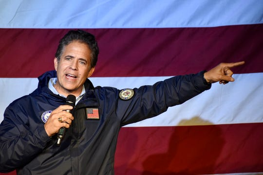 Congressman Mike Bishop, (R-Rochester), US congressional candidate for Michigan's 8th district, hits the stage.