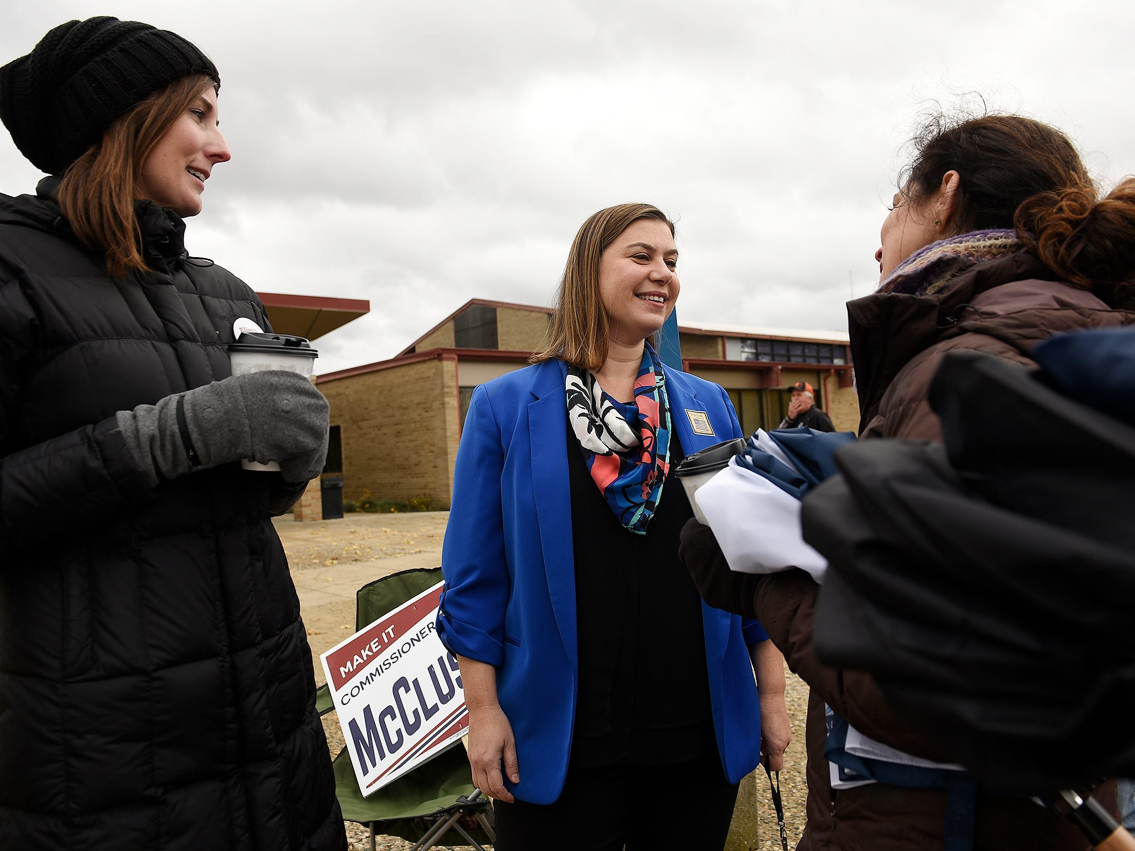 Elissa Slotkin, Democratic candidate for U.S. House of Representatives, talks to supporters Leigh Fullenkamp, left, 35, of Columbus, Ohio, and sister-in-law Amy Gottesman, 41, of St. Louis after casting her ballot at the Karl Richter Community Center in Holly on Nov., 6, 2018.