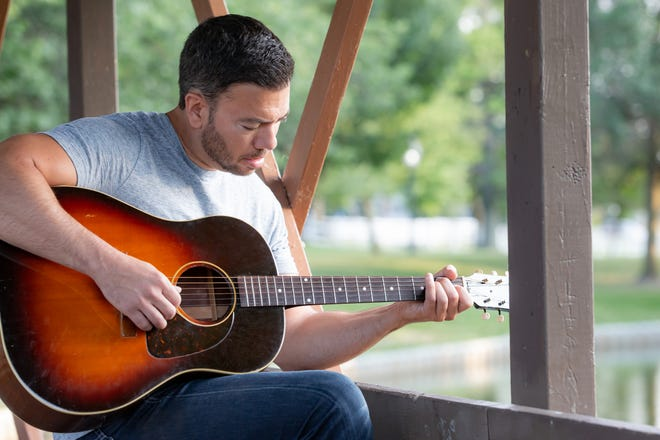 Singer and songwriter Joe Jaber performs with his band Saturday at the Lyft Lounge above Hockeytown Cafe.