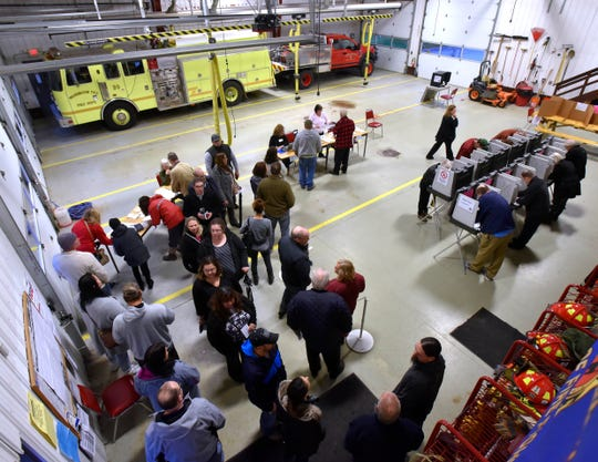 Voter lines serpentine at Precinct 1 inside the Armada Twp. Fire Station Tuesday morning. Among other ballot issues in Armada Twp. is a fire protection millage increase, which would provide additional funding for new fire trucks and fire fighting equipment replacement.