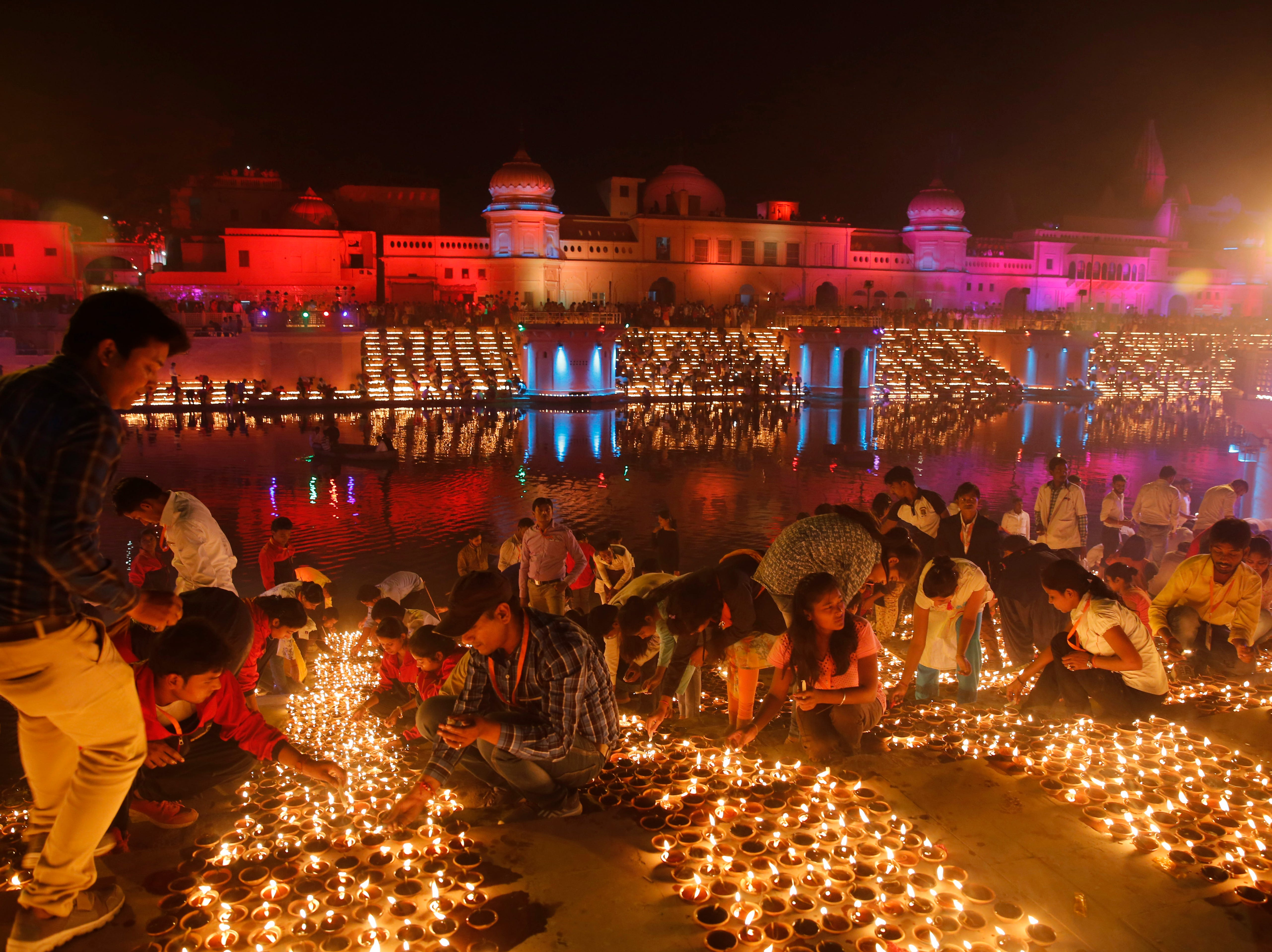 Devotees light earthen lamps on the banks of the River Sarayu as part of Diwali, the Hindu festival of lights celebrations in Ayodhya, India, India, Tuesday, Nov. 6, 2018. The northern Indian city of Ayodhya has broken a Guinness World Record after lighting 300,150 earthen lamps.