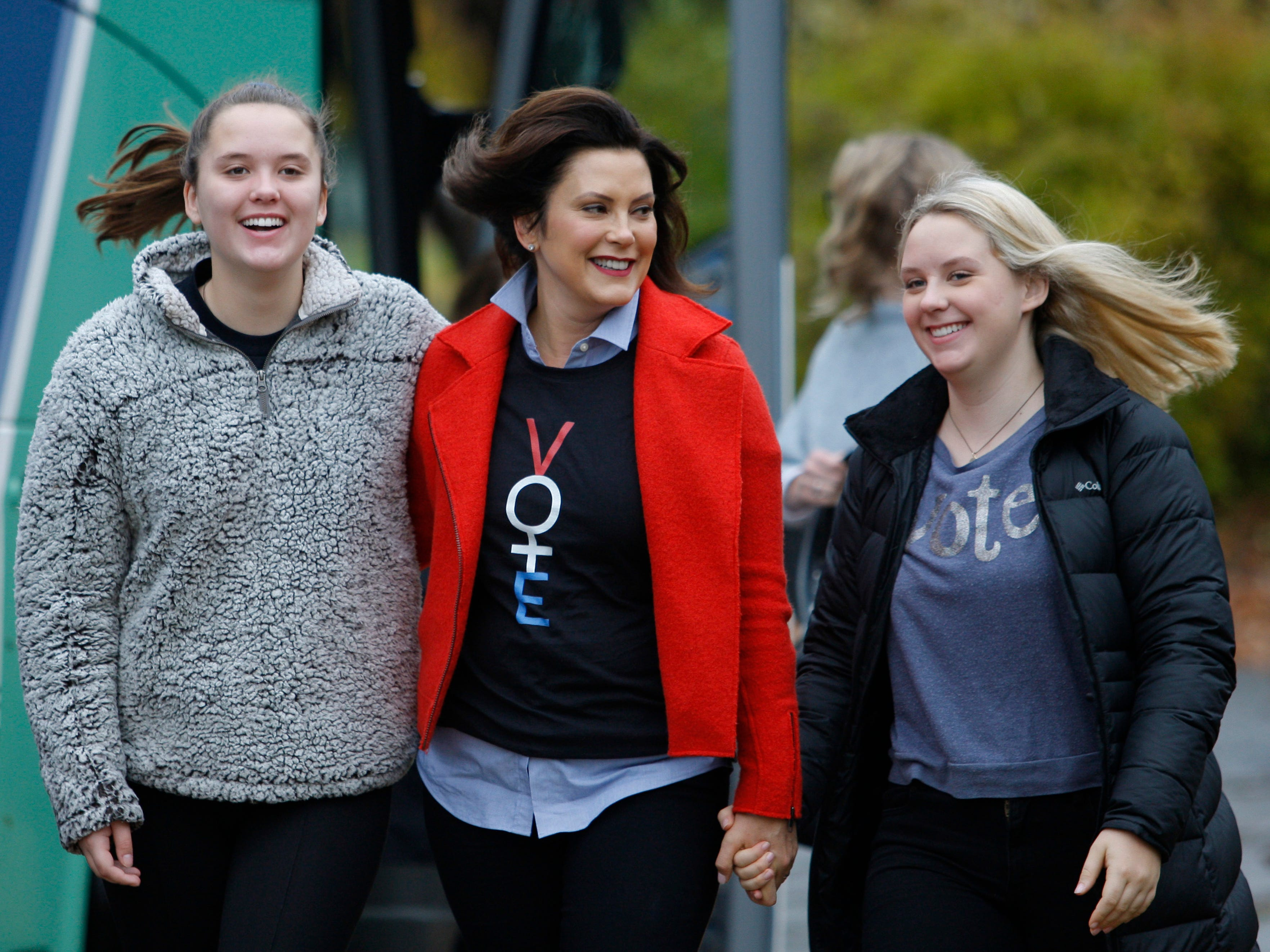 Michigan Democratic gubernatorial candidate Gretchen Whitmer, center, walks from her campaign bus to the polling place with daughters Sherry, left, and Sydney, Tuesday, Nov. 6, 2018, at St. Paul Lutheran Church in East Lansing.