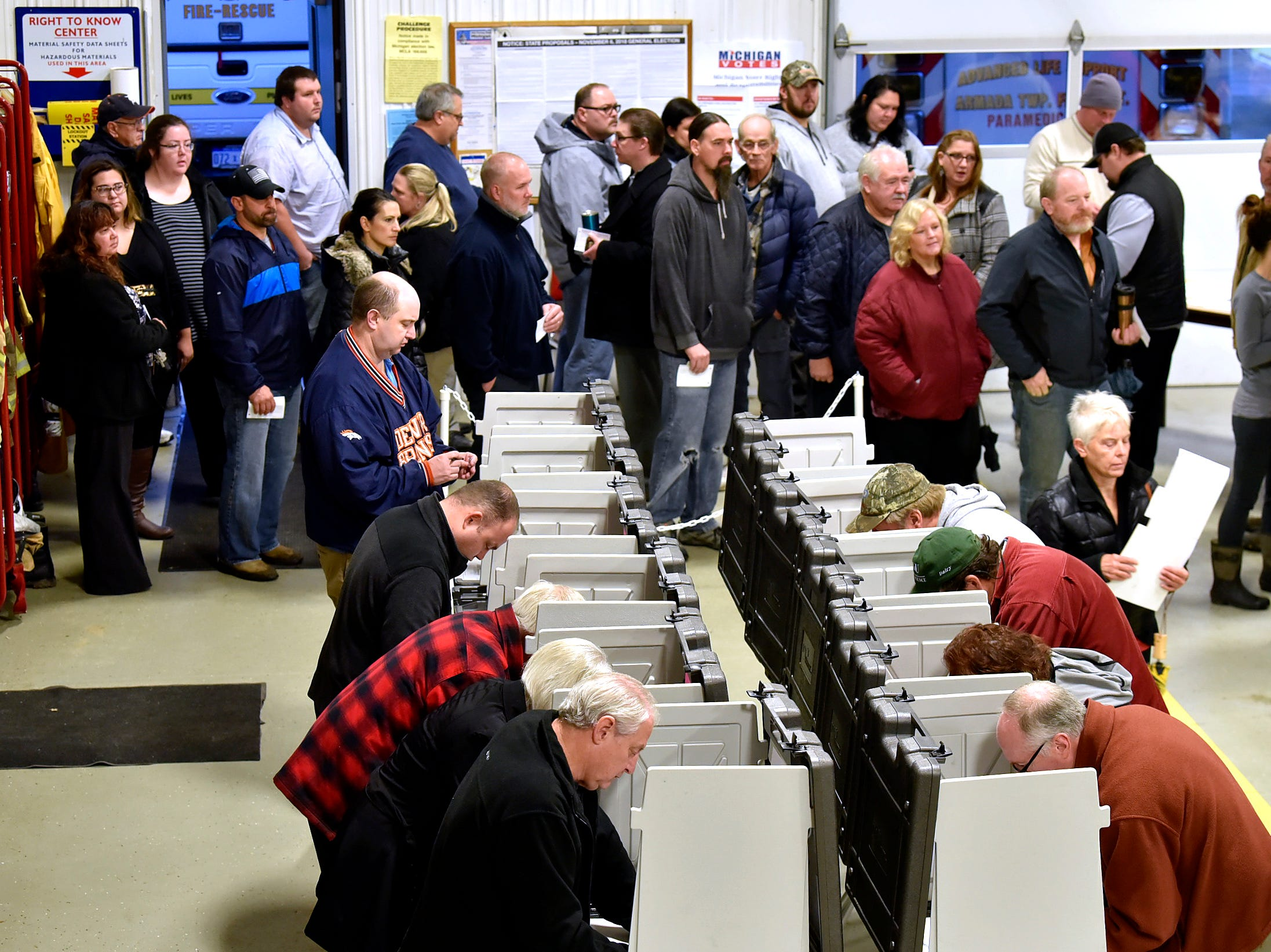Voter lines serpentine at Precinct One inside the fire bay at the Armada Twp. Fire Department, Tuesday morning, Nov. 6, 2018. Armada Township voters are considering an increase to a Fire Protection Millage, which would provide additional funding for new fire trucks and firefighting equipment.