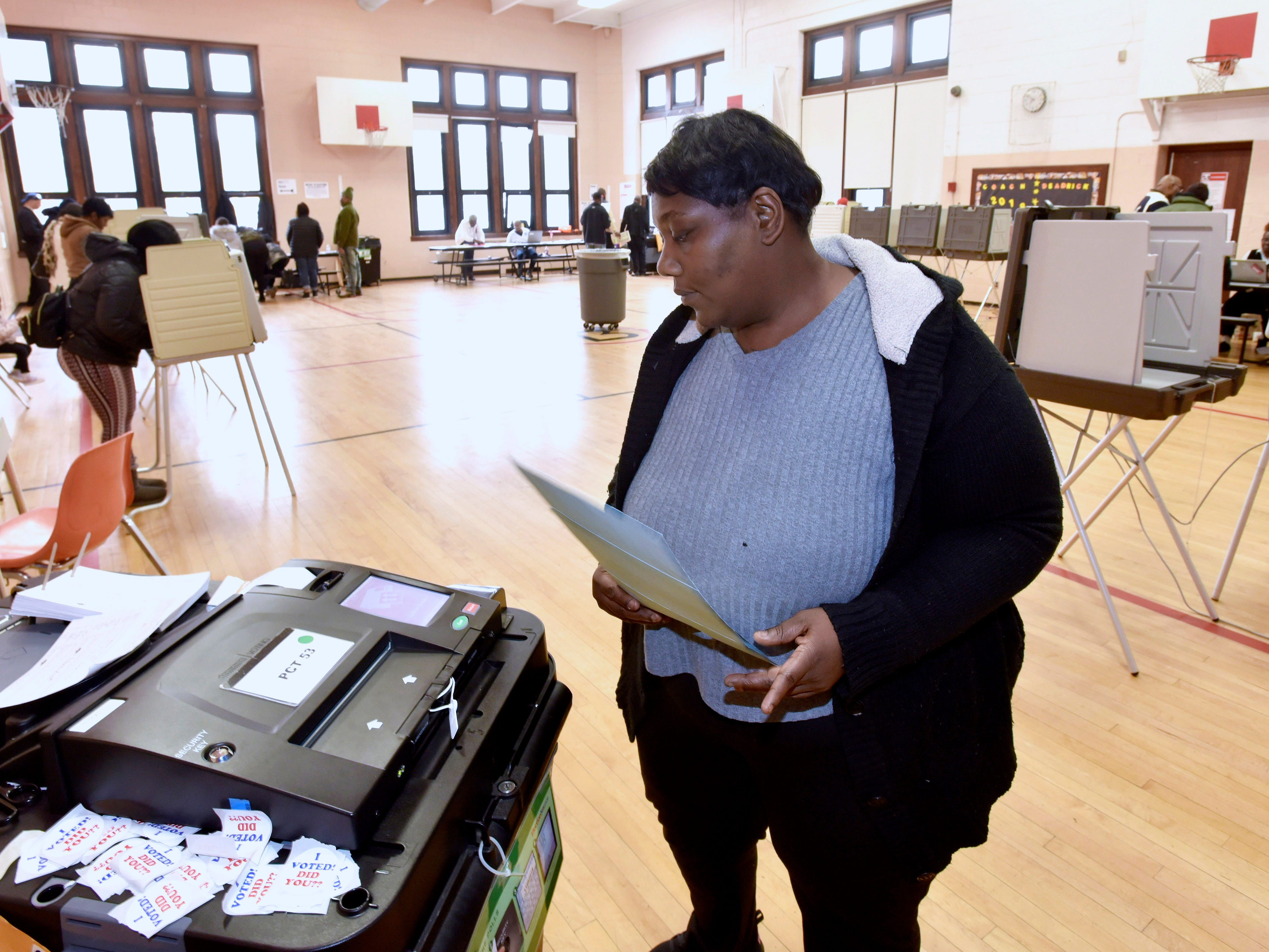 Charmiria Ashford of Detroit casts her ballot in the gym at Brewer Elementary School Tuesday afternoon in Detroit.