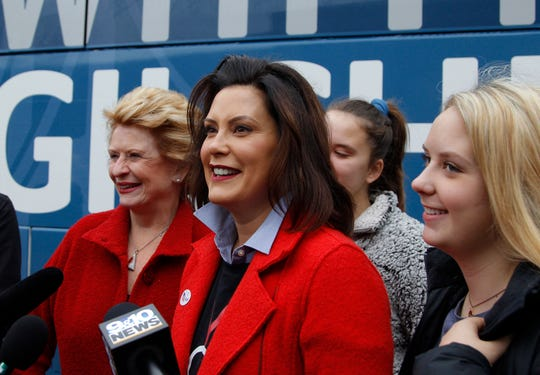 Michigan Democratic gubernatorial candidate Gretchen Whitmer answers questions with Sen. Debbie Stabenow, D-Lansing, left, and daughters Sherry, rear, and Sydney, right, after casting her ballot, Tuesday, Nov. 6, 2018, at St. Paul Lutheran Church in East Lansing.