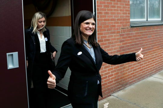 Haley Stevens, Democratic candidate for Michigan's 11th Congressional District, gives a thumbs up as she exits her polling place Tuesday,  in Rochester Hills.