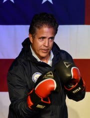 U.S. Rep. Mike Bishop, R-Rochester, who is running for reelection, hits the stage in boxing gloves as the 'Rocky' theme plays during a rally with other GOP candidates at the Legacy 925 Event Center in Oxford, Michigan on November 5, 2018. (Brandy Baker/ The Detroit News)