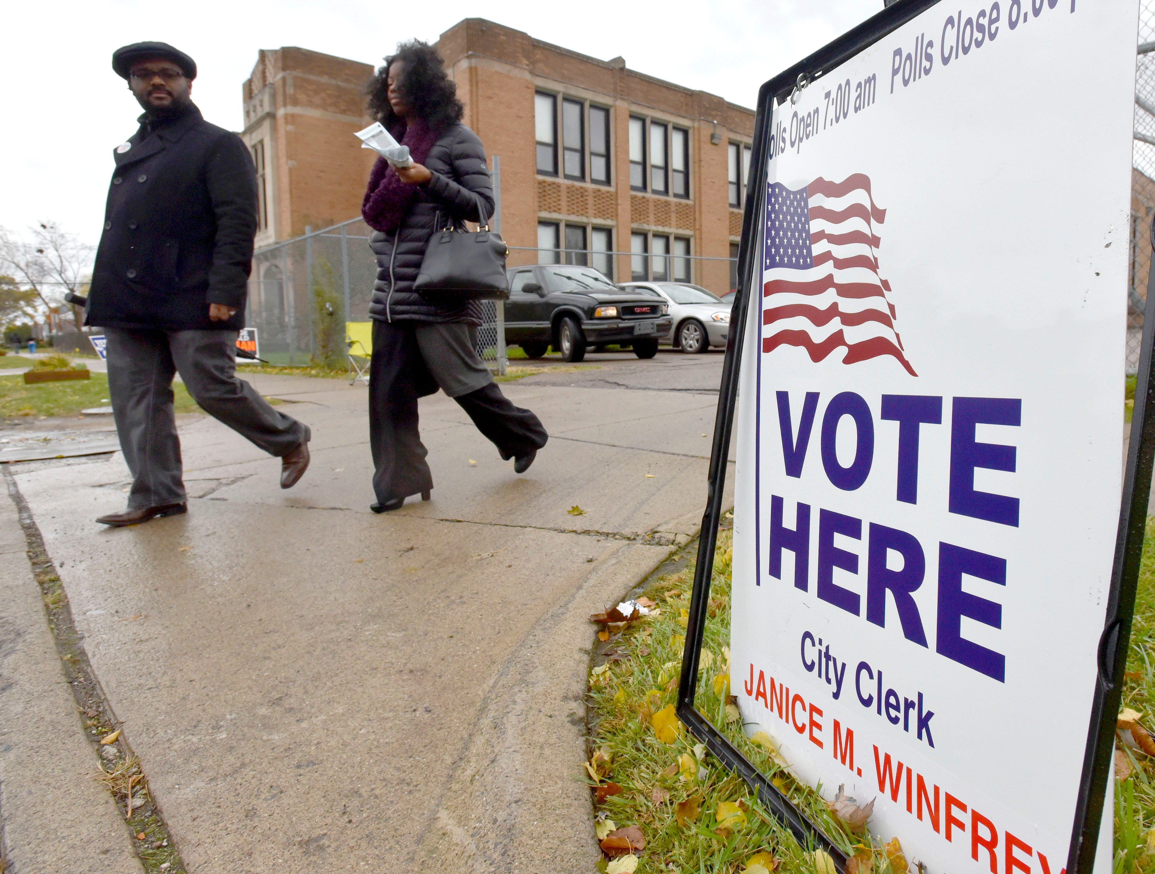 Residents leave after casting their ballots in the gym at Brewer Elementary School in Detroit, Tuesday afternoon, Nov. 6, 2018.